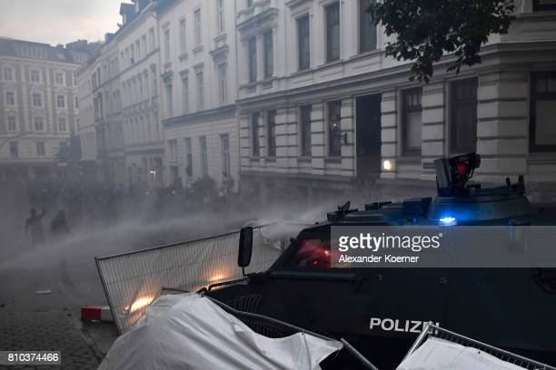 Police use water cannons and plough through the makeshift barricades during an antiG20 protest on July 7 2017 in Hamburg Germany Authorities are...