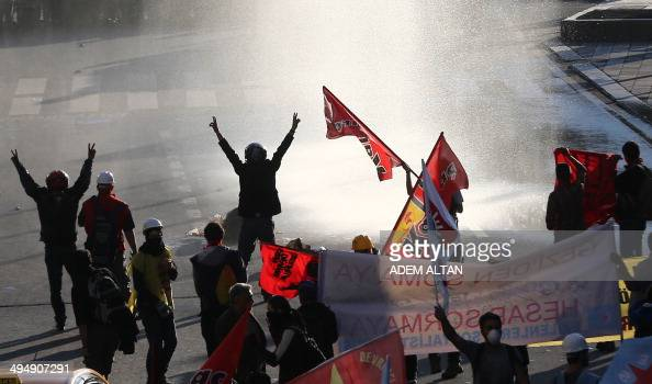 Police use water cannons and teargas to disperse demonstrators in Ankara on the first anniversary of last year's protests in Istanbul's Taksim square...