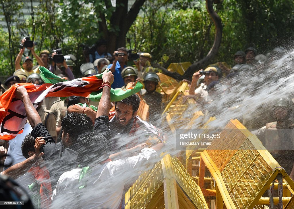 Police use water canons on Delhi BJP party workers during their protest demanding an apology from Sonia Gandhi and her party leaders on their statements over the Batla House encounter issue at Congress Headquarter on May 30, 2016 in New Delhi, India. BJP has latched onto an IS video where one of the men claimed that he was at Batla House when police had raided the premises and fled afterwards. Last week, Congress general secretary Digvijaya Singh had stoked a controversy after he dubbed the 2008 Batla House encounter as fake.