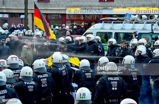 Police use water to control supporters of Pegida Hogesa and other rightwing populist groups as they protest against the New Year's Eve sex attacks on...