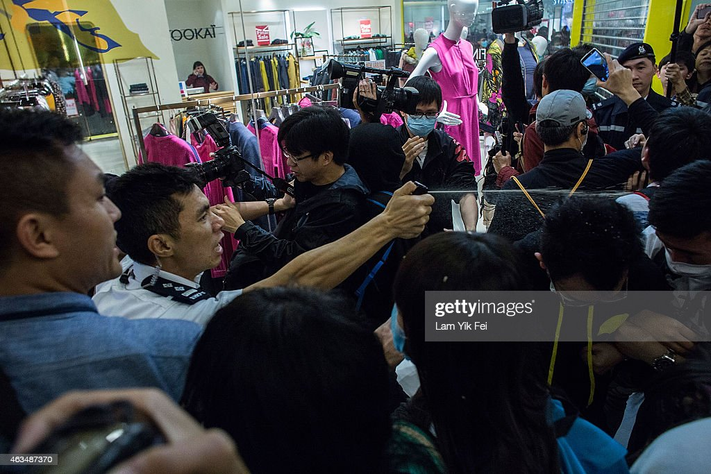 Police uses pepper spray and batons to suppress the protesters in Shatin during a rally against parallelgoods trading on February 15 2015 in Hong...
