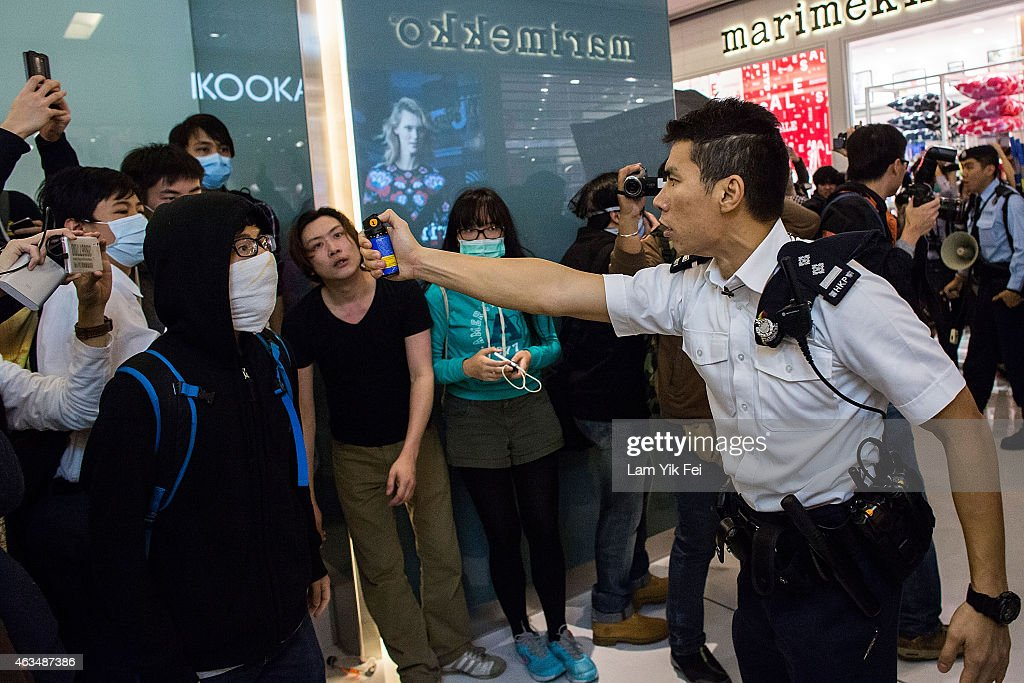 Police uses pepper spray and batons to suppress the protesters in Shatin during a rally against parallel-goods trading on February 15, 2015 in Hong Kong. Protestors say the growing number of mainland parallel-goods traders has impacted their daily lives, and similar protest was taken place in Tuen Mun one week earlier.