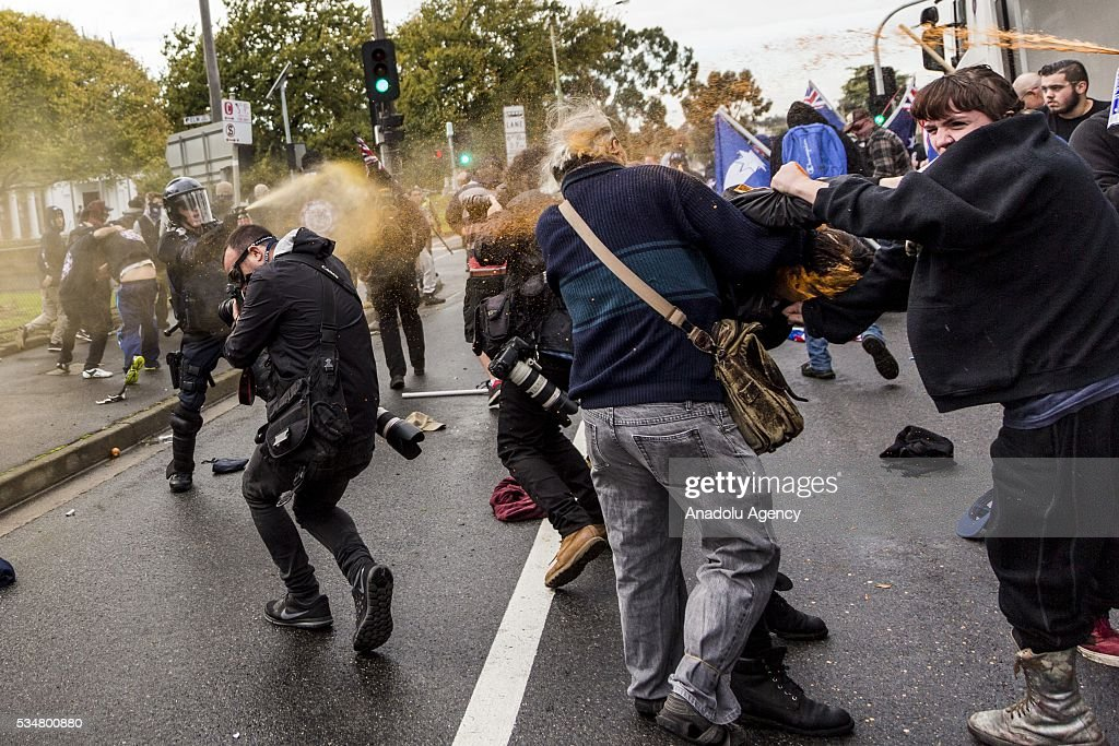 Police uses pepper spray to end fight between Anti Fascists and True Blue Crew members during a 'Say No To Racism' protest and a counter 'Stop the Far Left' rally in Coburg Melbourne, Australia on May 28, 2016. Seven men were arrested after a violent brawl erupted between rival protesters at an anti-racism rally in Melbourne's inner-north. Anti-Facists clashed with Anti-Islam nationalists who go by the name 'True Blue Crew'.