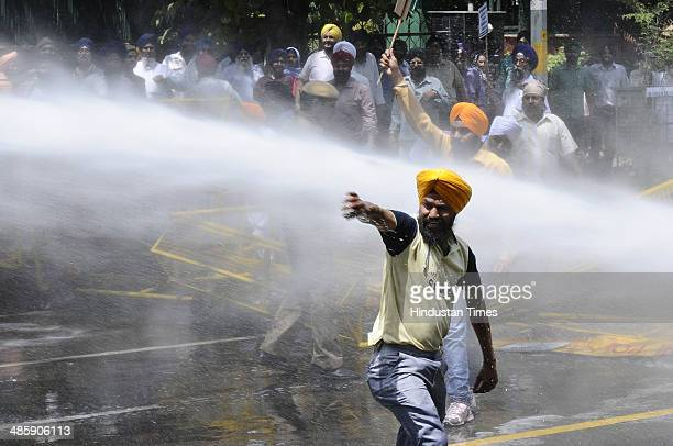 Police using water canons to disperse members of Akali Dal who are protesting over former Punjab chief minister Amarinder Singhs alleged clean chit...