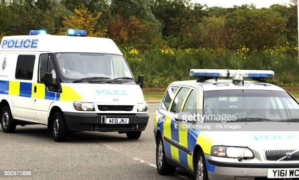 A Police van carrying Ian Huntley the accused murderer of Soham school girls Jessica Chapman and Holly Wells arrives at Woodhill Prison in Milton...