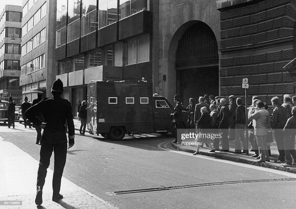 A police van carrying serial killer Peter Sutcliffe, also known as the Yorkshire Ripper, arrives at the Old Bailey, London, during his trial on 13 counts of murder, 5th May 1981.