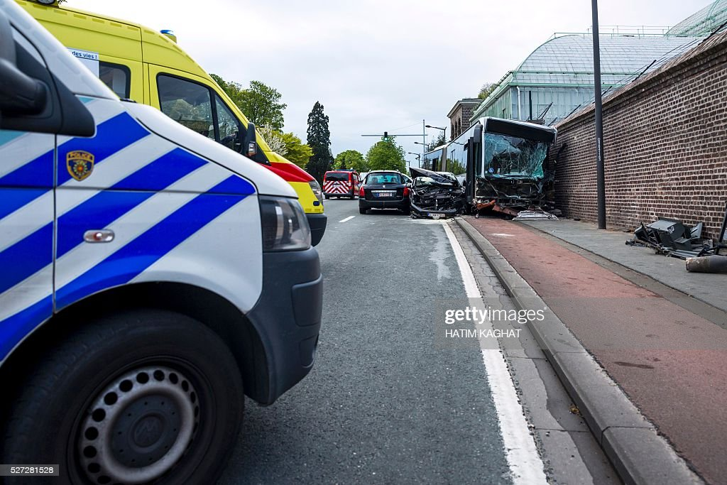 A police van is parked at the site of an accident between a Brussels public transport MIVB/STIB bus and a van outside the Royal castle in Laken/Laeken, in northwest Brussels, on May 2, 2016, in which ten people were injured. The bus hit the wall surrounding the castle grounds after the van crashed into it injuring ten people, according to police. / AFP / Belga / HATIM KAGHAT / Belgium OUT