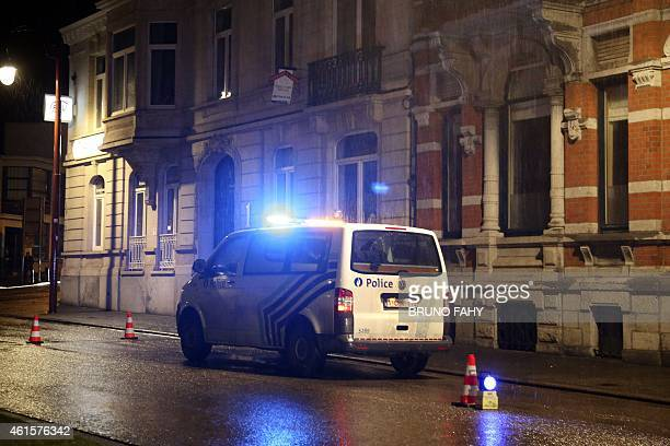 A police van is parked in a street as police set up a large security perimeter in the city center of Verviers eastern Belgium where three people were...
