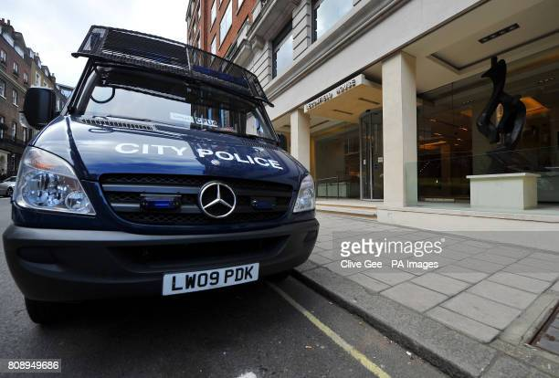 A Police van outside Leconfield House Curzon Street in central London