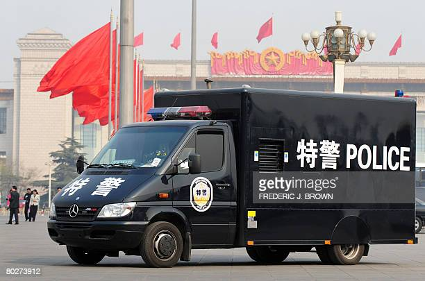 A police van patrols Tiananmen Square during a session at the Great Hall of the People of the National People's Congress China's annual rubberstamp...