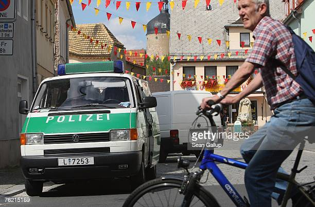 A police van stands near the Picobello Pizzeria August 22 2007 in Muegeln Germany A group of approximately 50 youths some of whom yelled 'Foreigners...