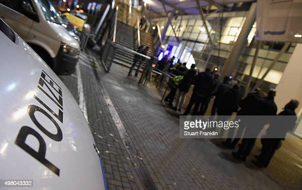 Police vans are seen outside of the stadium before the Bundesliga match between Hamburger SV and Borussia Dortmund at Volksparkstadion on November 20...