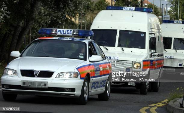 Police vans arrive at Bow Street magistrates court sitting at Belmarsh Eight men arrived at the court today under a heavy police escort to face...