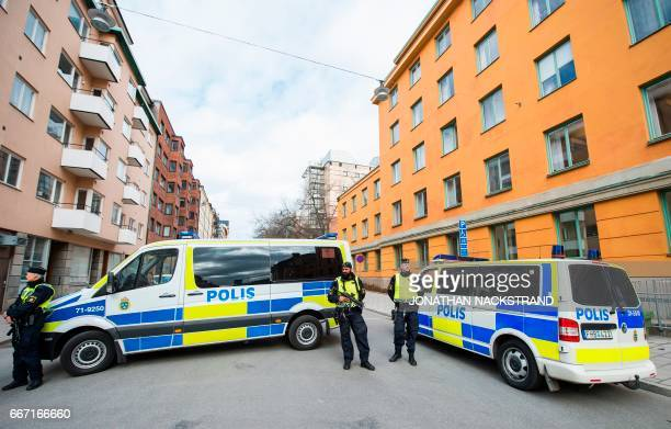 Police vans block the street outside the Stockholm District Court as Uzbek national Rakhmat Akilov prime suspect in the Stockholm truck attack...
