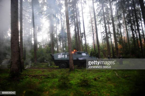 A police vehicle burns after it was set alight by anti nuclear protestors on November 7 2010 in the woods near in Metzingen Protests are underway...