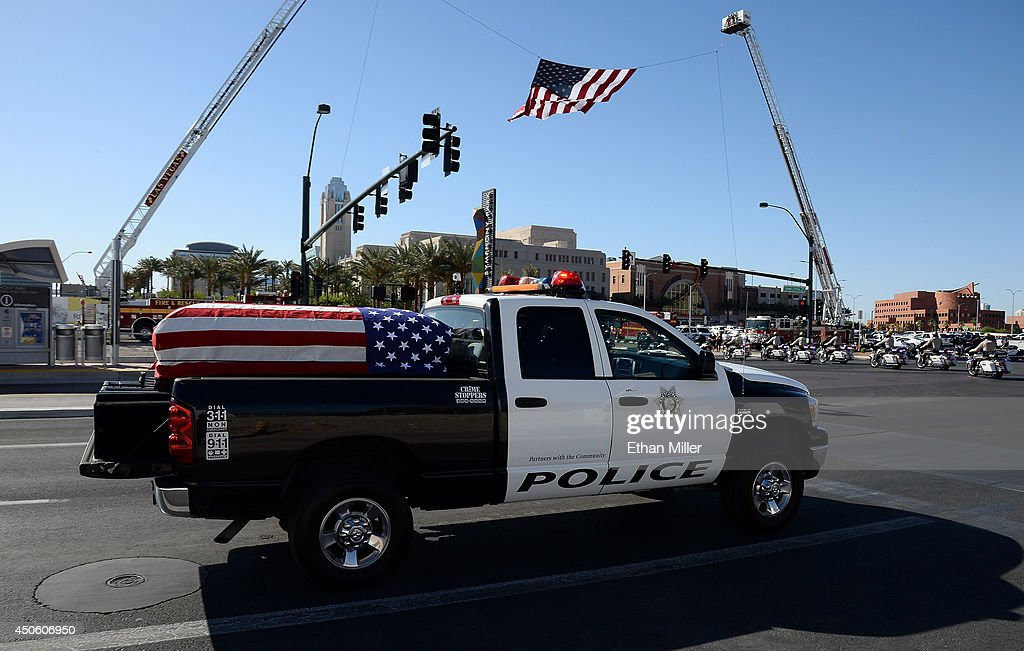 A police vehicle carrying a flag-draped casket arrives at the funeral for Las Vegas Metropolitan Police Department Officer Alyn Beck at The Smith Center for the Performing Arts on June 14, 2014 in Las Vegas, Nevada. Police said Beck and Officer Igor Soldo were shot and killed on June 8 at a restaurant by Jerad Miller and his wife Amanda Miller. Police said the Millers then went into a nearby Wal-Mart where Amanda Miller killed Joseph Wilcox before police killed Jerad Miller and Amanda Miller killed herself.