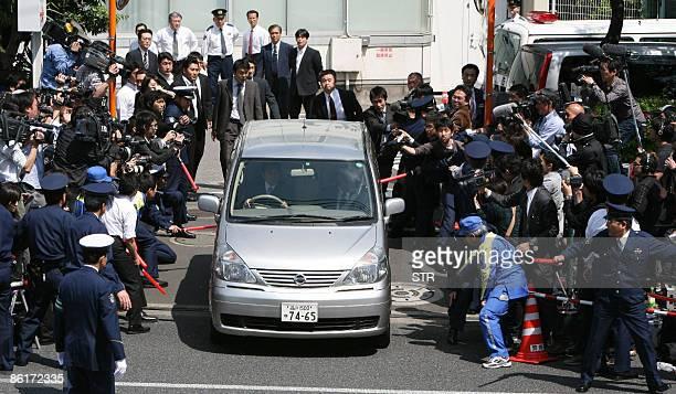 A police vehicle carrying Japanese singer Tsuyoshi Kusanagi leaves Tokyo's Akasaka police station on April 23 2009 Kusanagi was arrested on suspicion...