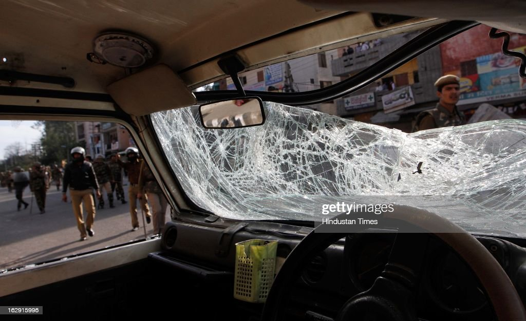 A police vehicle damaged by the mob near Sanjay Gandhi hospital during a protest after an eight-year-old girl, student of Class 2, was allegedly raped inside the premises of a North Delhi Municipal Corporation school at Mangolpuri Area on March 1, 2013 in New Delhi, India.