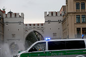 A police vehicle is parked at Stachus in the city center as police respond to the shooting at the Olympia Einkaufzentrum on July 22 2016 in Munich...