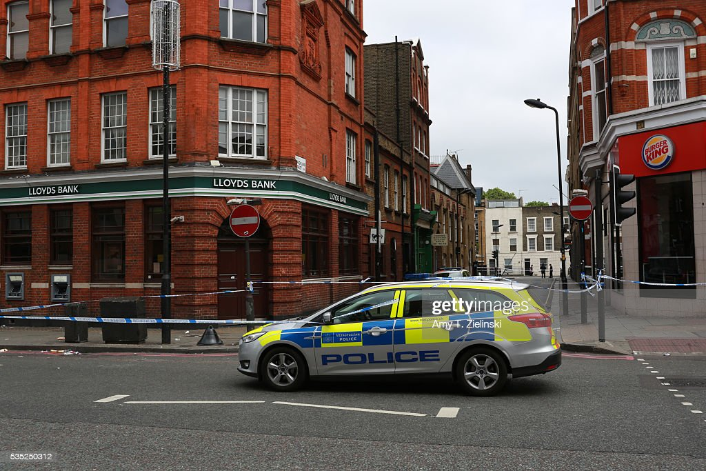 A police vehicle is parked in front of a cordon off section of Camden High street as a murder investigation is underway in Camden on May 29, 2016 in London, England. Reportedly a stabbing took place in the area leaving one man dead after being taken to the hospital.