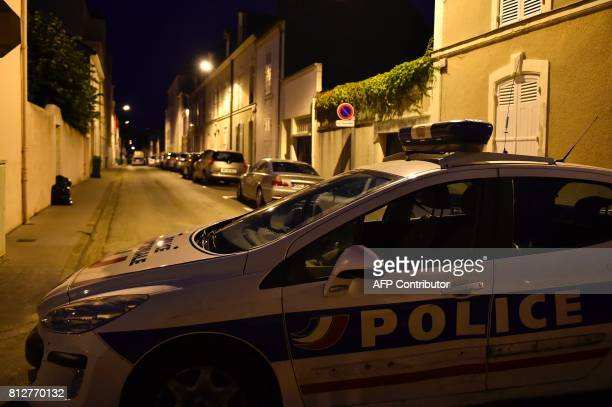 A police vehicle is parked on the road as police officers cordon off the area next to the house of late French magistrate JeanMichel Lambert who was...