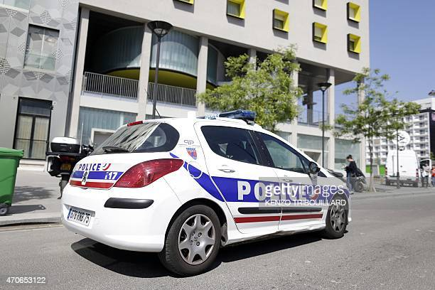 A police vehicle is parked outside the student residence where an It student suspected of planning a church attack in France lived in Paris on April...