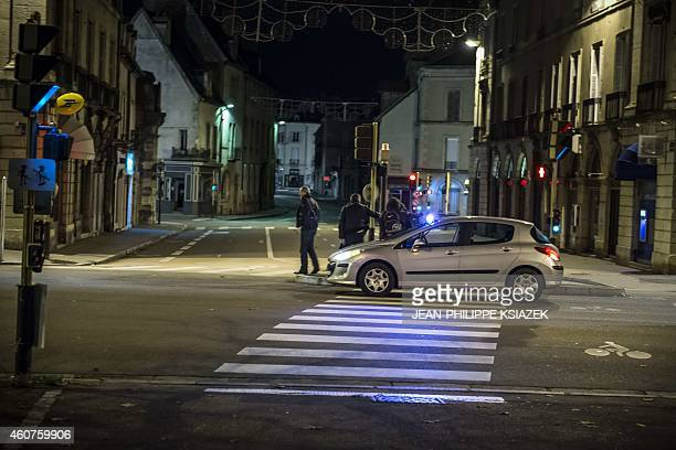 A police vehicle is seen on December 21 2014 in Dijon at the site where a driver shouting 'Allahu Akbar' ploughed into a crowd injuring 11 people two...