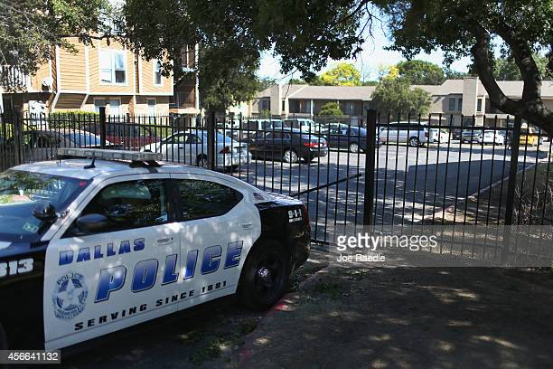 A police vehicle is seen parked in front of the Ivy Apartment complex where the confirmed Ebola virus patient was staying on October 4 2014 in Dallas...