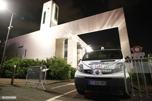 A police vehicle is stationed outside a mosque June 29 2017 in the Paris suburb of Creteil after a man tried to drive a car into a crowd in front of...