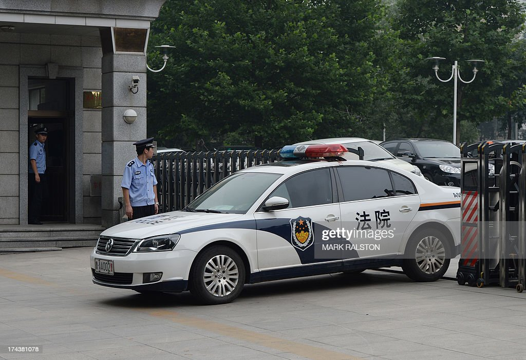 A police vehicle leaves the Intermediate People's Court where Chinese politician Bo Xilai was indicted and his case is expected to be heard in Jinan, Shandong Province on July 25, 2013. China's once-powerful politician Bo Xilai has been indicted for bribery, corruption and abuse of power. The former party chief of the southwestern city of Chongqing has not been seen in public for more than a year since the controversy surrounding him was exposed, triggering one of China's biggest political scandals in decades. AFP PHOTO/Mark RALSTON