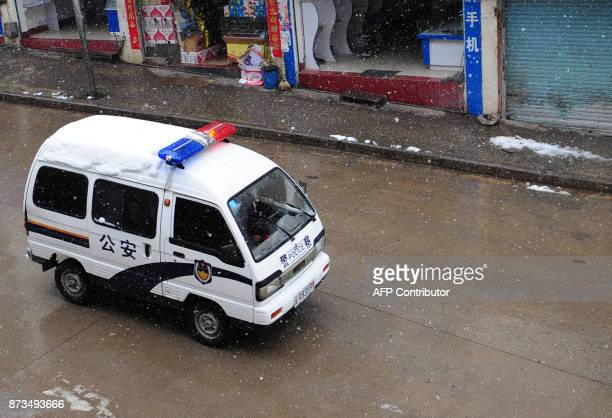 A police vehicle patrols the normally busy main street in Deqin on March 21 2008 in the Diqing Tibetan Autonomous Prefecture of southwest China's...