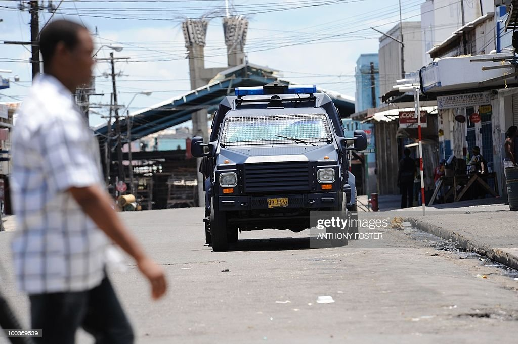 A police vehicle patrols the street on May 24, 2010 in Kingston, Jamaica after two police officers were killed after coming under attack amid spreading unrest despite a state of emergency imposed by the government. Six police were wounded in the incident on Sunday after police responded to a call for help from a female motorist, the Jamaican police force's Constabulary Communications Network said. It said the two police officers died after being taken to the University of the West Indies Hospital. Jamaica's prime minister vowed tough action against a frenzy of gang violence in Kingston, imposing a state of emergency to curb armed supporters of an alleged druglord sought by the United States.