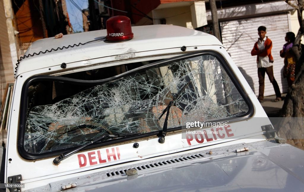 A police vehicle ransacked by the mob near Sanjay Gandhi hospital during a protest after an eight-year-old girl, student of Class 2, was allegedly raped inside the premises of a North Delhi Municipal Corporation school at Mangolpuri Area on March 1, 2013 in New Delhi, India.
