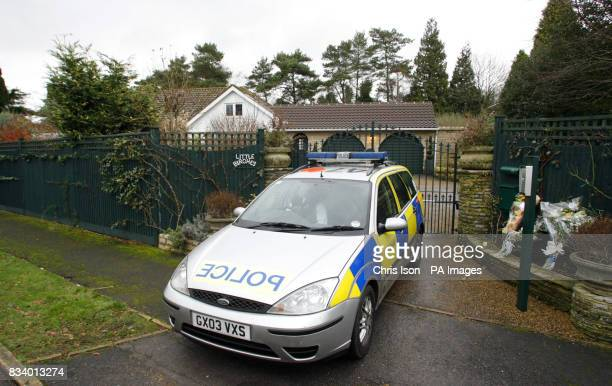 A police vehicle sits outside the home of Roger and Sue Goswell in West Chiltington West Sussex where police believe Mr Goswell murdered his wife...