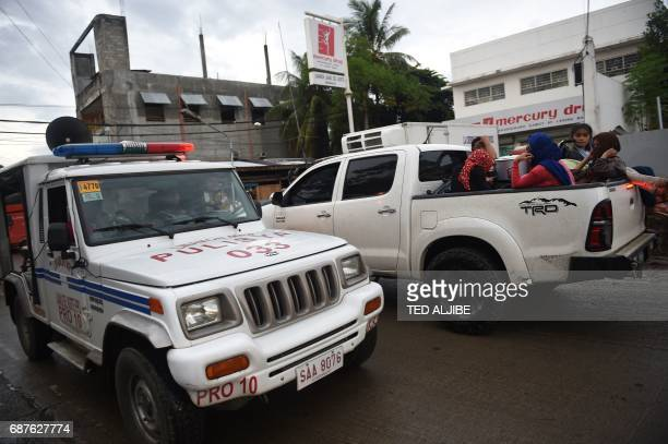 A police vehicle with a public system announcing the implementation of martial law in Mindnanao island advises residents of curfew hours from 10 in...