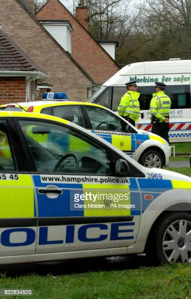 Police vehicles and officers are seen outside a house on Wellington Crescent in Baughurst Hampshire where explosive devices are believed to have been...