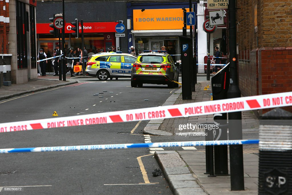 Police vehicles are parked inside a cordon off section of Greenland street and Greenland Place as a murder investigation is underway in Camden on May 29, 2016 in London, England. Reportedly a stabbing took place in the area leaving one man dead after being taken to the hospital.