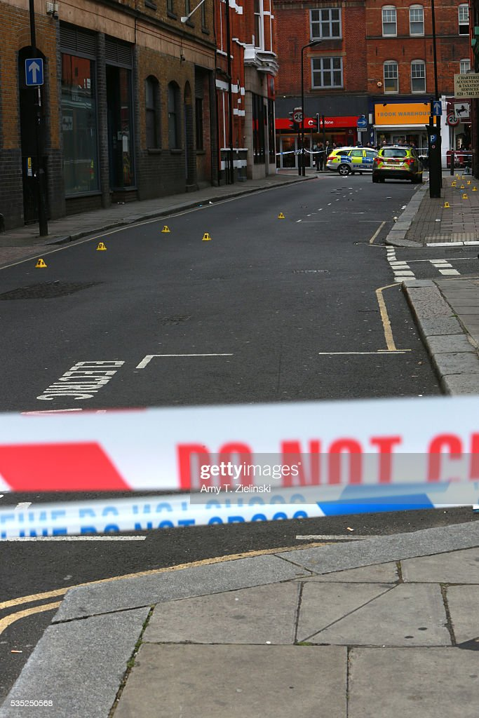 Police vehicles are parked inside a cordon off section of Greenland street as a murder investigation is underway in Camden on May 29, 2016 in London, England. Reportedly a stabbing took place in the area leaving one man dead after being taken to the hospital.