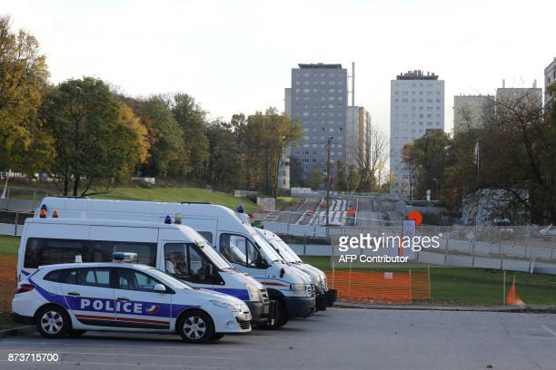 Police vehicles are parked near the construction site of public transportation on November 13 in ClichysousBois northern Paris / AFP PHOTO / LUDOVIC...