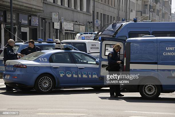 Police vehicles are parked outside Milan's court after a shooting on April 9 2015 An armed man identified as Claudio Giardiello facing bankruptcy...