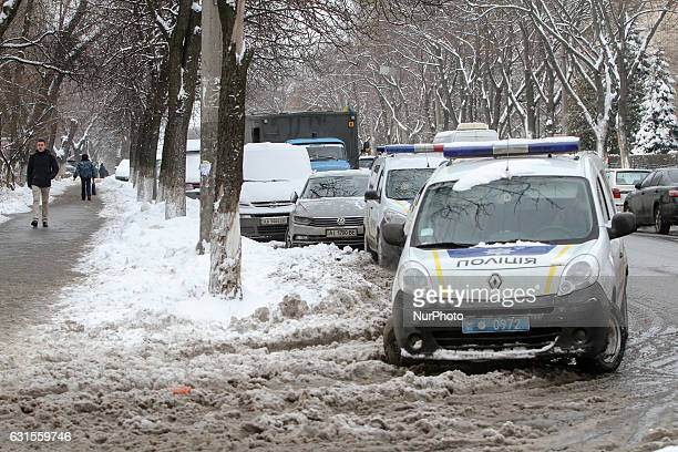 A police vehicles are seen parked Lukyanivske PTDC where a prisoner cut his ear to protest overnight into January 12 2017 in Kyiv Ukraine A conflict...