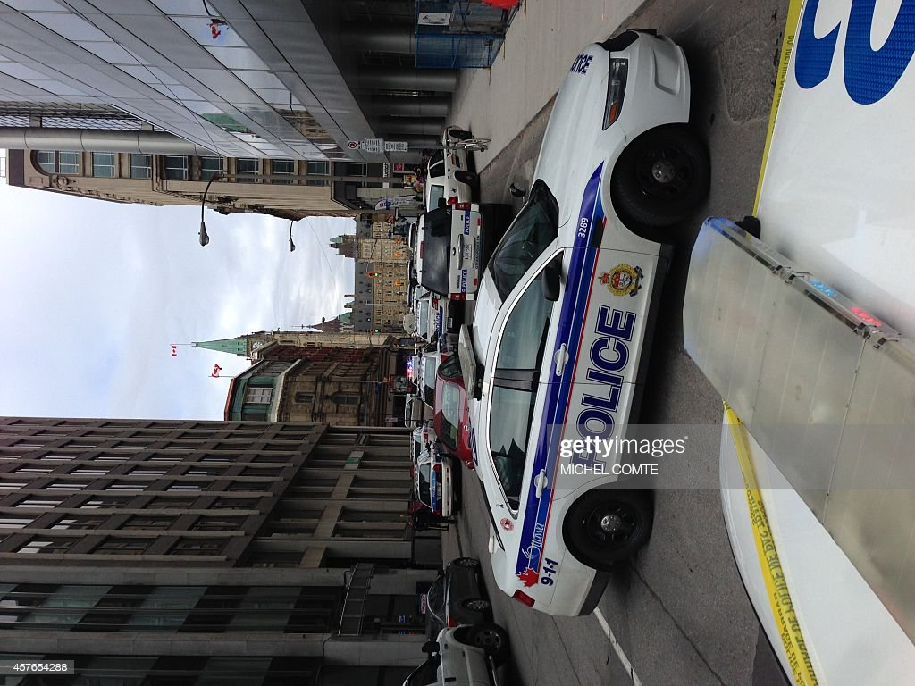 Police vehicles block a road near Parliament on October 22 2014 in Ottawa Ontario Heavilyarmed Canadian police backed by armored vehicles and...
