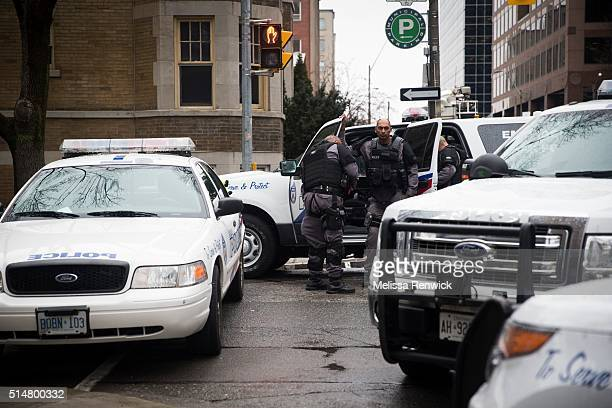 TORONTO ONTARIO MARCH 10 Police vehicles block the corner of Church Street and and Charles Street East as negotiators try to talk a distressed woman...
