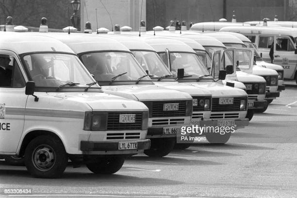 Police vehicles lined up in the vicinity of St James's Square London where the Libyan People's Bureau is in a state of siege since the shooting of...