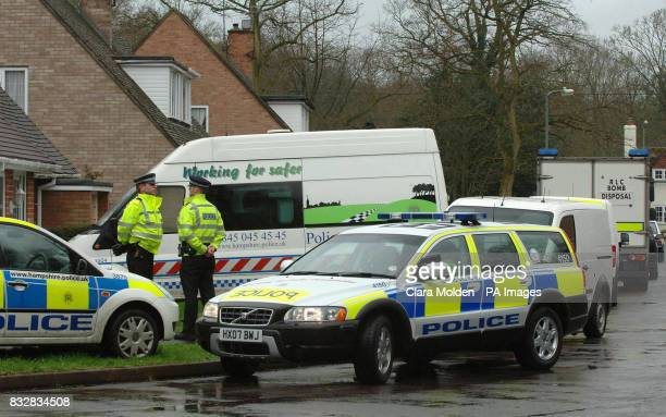 Police vehicles officers and a bomb disposal unit are seen on Wellington Crescent in Baughurst Hampshire where explosive devices are believed to have...