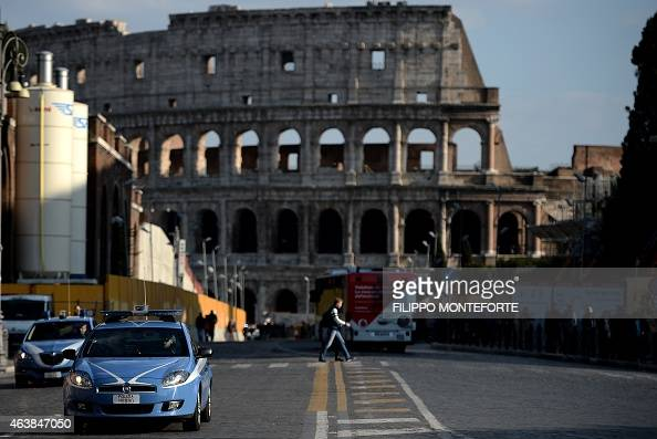 Police vehicles patrols near the Colosseum on February 19 2015 in Rome Security at the Vatican and across Italy has been stepped up because of a...