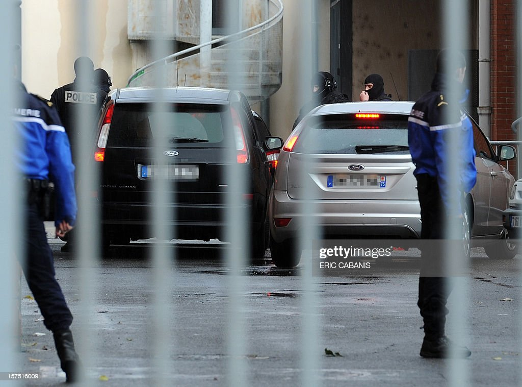 Police vehicles, reported to be bringing two alleged accomplices of gunman Mohamed Merah for questioning, arrive on December 4, 2012 at Toulouse's police station. French police arrested two alleged accomplices of gunman Mohamed Merah, whose Al-Qaeda-inspired shooting spree in and around the southern city of Toulouse earlier this year left seven people dead. A man, identified as Charles Mencarelli and described by police as a member of the traveller community, was arrested at his home in the town of Albi, about 70 kilometres (45 miles) northeast of Toulouse, and his former partner was arrested separately at her home in Toulouse.
