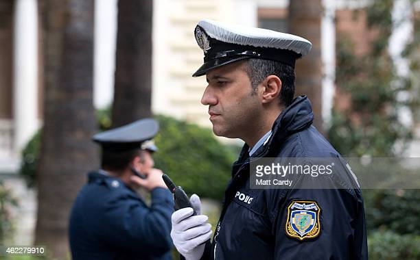 Police wait by the gate as Syriza party leader Alexis Tsipras is sworn in by Greek President Karolos Papoulias as GreeceÕs new Prime Minister at the...
