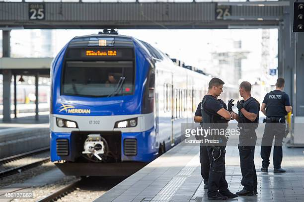 Police wait for a train arriving from Austria at Munich Hauptbahnhof main railway station on September 1 2015 in Munich Germany Over a thousand...