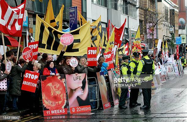 Police walk around abortion protestors holding up placards outside the Marie Stopes clinic the first private clinic to offer abortions to women in...